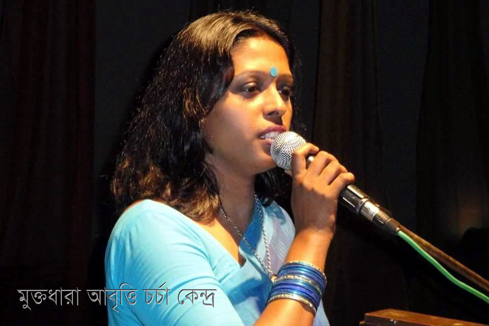 Nasima Khan Bakul in Front of a Microphone